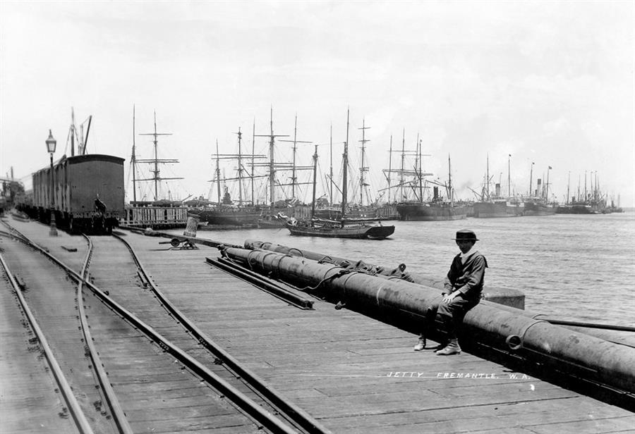 Heritage photo of man sitting by Fremantle Wharf